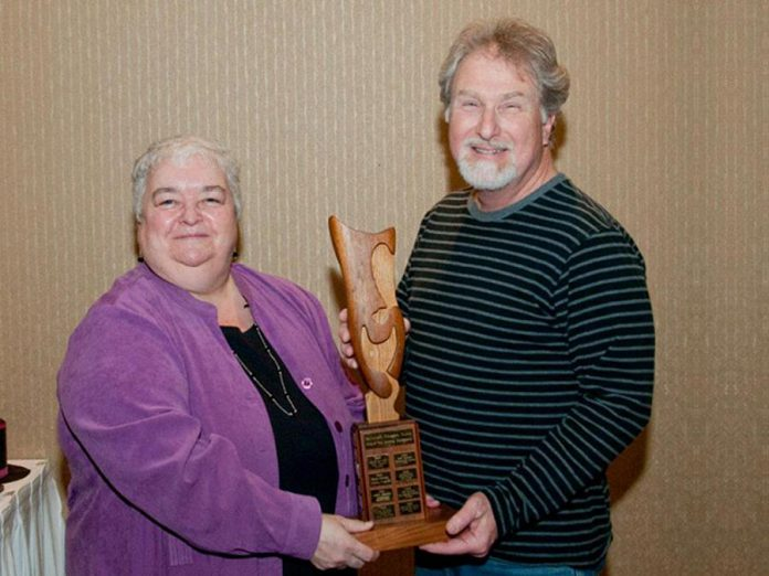 "Terry Novak receiving an award for Acting Excellence in 2012 from the Eastern Ontario Drama League for his role in the Peterborough Theatre Guild production of ""The Mouse House"". (Photo: Peterborough Theatre Guild)"
