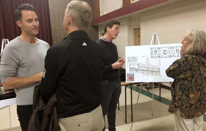 Ashburnham Realty owner Paul Bennett (left) and architect Michael Gallant of Lett Architects (second from right) engaged a number of residents Thursday night (October 24) at an open house and information session concerning plans for the mixed-use residential-commercial development of several properties in East City. (Photo: Paul Rellinger / kawarthaNOW.com)
