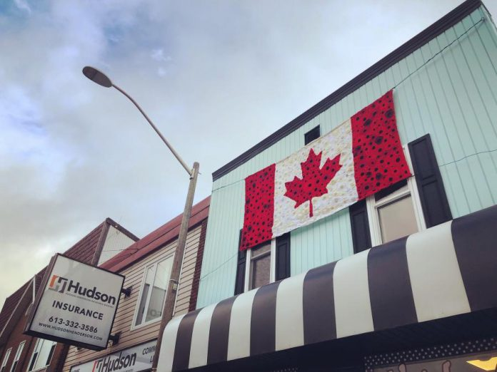 Hospice volunteers have hand crafted this large Canadian flag of poppies, which is hanging at Vintage on Hastings, the shop operated in downtown Bancroft by Hospice North Hastings. In previous years, hospice volunteers have used their skills for other large-scale projects to commemorate Remembrance Day. (Photo: Barb Shaw)