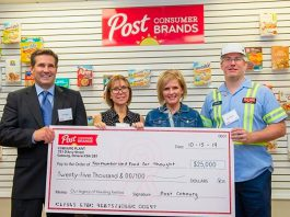 Northumberland Food for Thought community development coordinator Beth Kolisny and public health dietician Kimberly Leadbeater accept a cheque for $25,000 from Post Consumer Brands on October 15, 2019 in Cobourg. (Photo: Haliburton, Kawartha, Pine Ridge District Health Unit / Facebook)