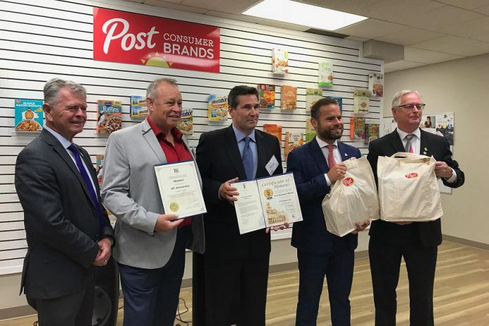 Post Consumer Brands donated $25,000 to Northumberland Food for Thought during the 40th anniversary celebration at the company's Cobourg plant on October 15, 2019, when the Ontario government also announced $412,700 in funding to help expand production capacity at the company's plants in Cobourg and Niagara Falls. Pictured are Cobourg Mayor John Henderson (right) and Peterborough-Northumberland MPP David Piccini (second from right), who attended the celebration, with Piccini announcing the funding. (Photo: Town of Cobourg / Facebook)