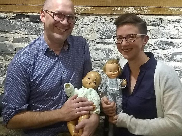 Ben Hatcher and Kathryn Bahun with two of the dolls from their collection, which will be on display at The Theatre on King in downtown Peterborough on October 29 and 30, 2019. (Photo: Sam Tweedle / kawarthaNOW.com)