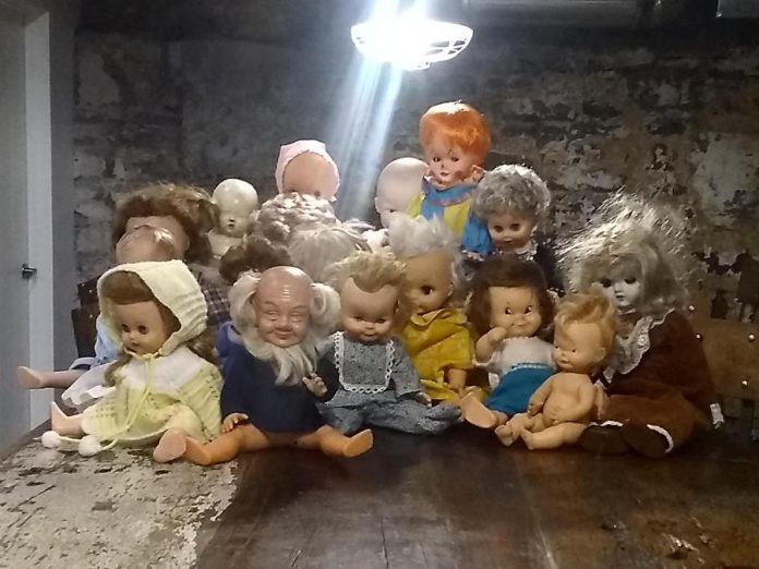 Kathryn Bahun and Ben Hatcher have been collecting discarded dolls for almost two years, and have amassed a collection of 50 of them. Even illuminated by a bright light, the dolls still have a strong creep factor. (Photo: Sam Tweedle / kawarthaNOW.com)