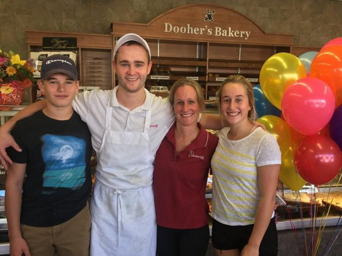 Dooher's Bakery owner Cory Dooher (second from right) with her children Spencer, Jeremy, and Hannah, who also work at the bakery. (Photo courtesy of Dooher's Bakery)