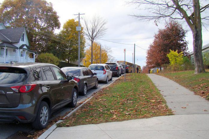 A common sight at Peterborough-area schools during drop-off and pick-up times: a long line of idling cars on Robinson Street beside Immaculate Conception Catholic Elementary School in Peterborough's East City. Empty sidewalks are an indication that there is potential to shift towards active methods of school travel instead of relying on cars. Relying on cars for school travel reduces air quality, physical activity, and opportunities for independence while also increasing social isolation. To help address these issues, Immaculate Conception is one of five local schools participating in the new School Travel Planning program delivered by GreenUP and Active and Safe Routes to School Peterborough. (Photo courtesy of GreenUP)
