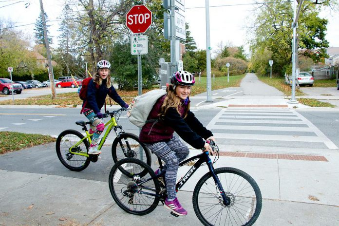 Children ride their bikes at the Rotary Greenway Trail at Douro Street in Peterborough's East City. Whereas relying on cars for school travel can increase isolation and reduce physical activity, cycling or walking to school with friends can provide valuable social and active time for kids. (Photo courtesy of GreenUP)