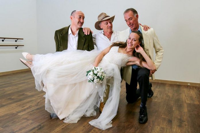 """In the St. James Players' production of """"Mamma Mia!"""", Sophie Sheridan (Gillian Harknett) invites the three men who might be her father -- Harry Bright (Keevin Carter), Bill Austin (Mark Gray), and Sam Carmichael (Warren Sweeting) -- to her wedding on a Greek island.  (Photo courtesy of St. James Players)"""