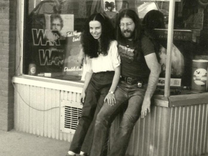 Mike Taveroff with his wife Cheryl in front of their original Moondance store at 249 George Street in downtown Peterborough in 1975. One of the reasons Mike decided to close the store in 2018 and retire was the death of Cheryl from cancer the previous year. Shortly after retiring, Mike was himself diagnosed with cancer and, after initial treatment made him ill, he decided to halt future treatments in favour of palliative care. His two daughters Jesse and Leigh and his close friend and former long-time Moondance employee Sue Logan were with him when Mike passed away in hospice on October 13, 2019. (Photo courtesy of the Taveroff family)