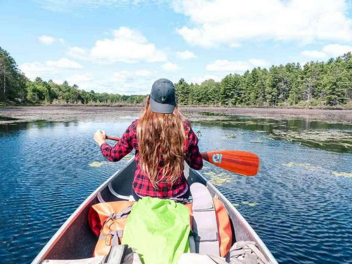 A member of the Toronto Bloggers Collective canoeing on Copper Lake in Kawartha Highlands Provincial Park. (Photo: walkaboot.ca)