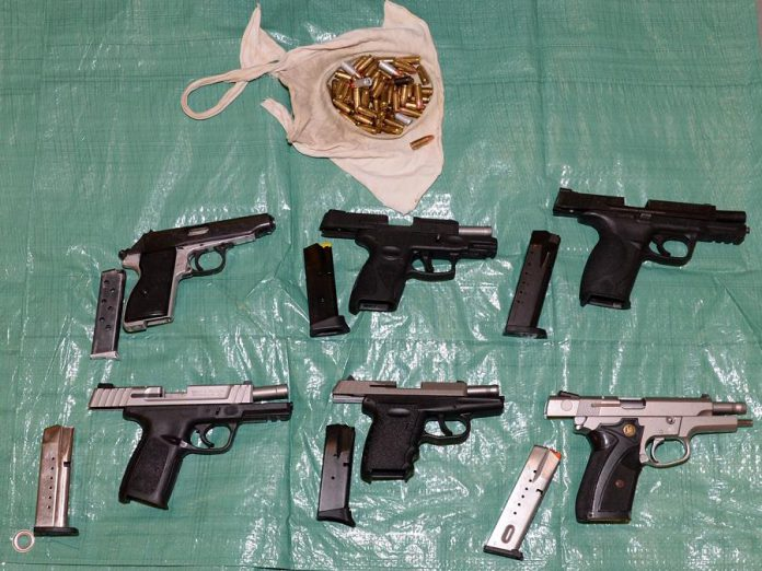 Police found these six handguns conealed in a hidden compartment in a car driven by one of the 11 people arrested after a joint police force investigation resulted in 13 search warrants being executed on October 30, 2019 in several communities in and around the Kawarthas. Police also seized significant quantities of drugs, cash, and other weapons. (Supplied photo)