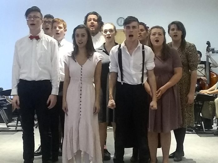 "The cast of ""Spring Awakening""  during a dress rehearsal at Catharine Parr Traill College: Drew Mills, Alessandra Ferrer,  and Kevin Lemieux (front row); Joseph Roper, Aimee Gordon, and Sarah Hancock (middle row); Carl Christensen, Rowan Lamoureux, Ryan Hancock, and Caitlin Currie (back row). The musical opens in Whitby on October 18th and 19th before coming to the Market Hall in downtown Peterborough from October 24th to 26th. (Photo: Sam Tweedle / kawarthaNOW.com)"