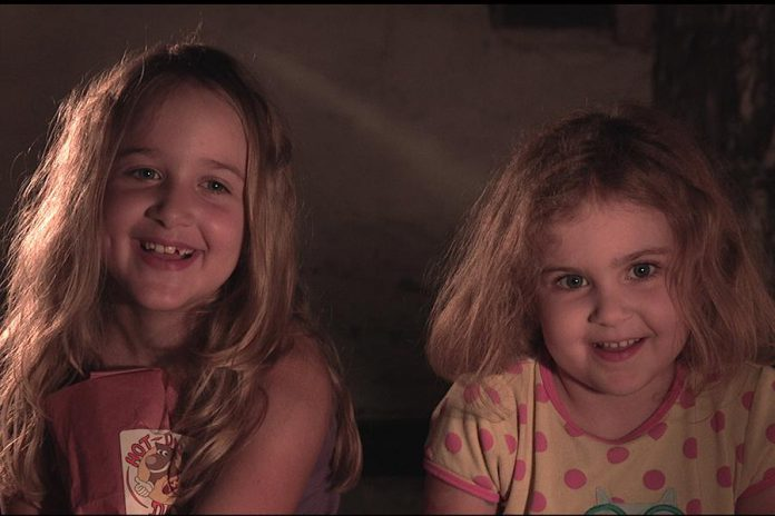 "Zoe Hayes and Emma Hayes, daughters of filmmaker Michael Hayes, play two sisters in the short film ""The Basement Monster"". The funny and moving family film explores both the power of sisterhood and being kind and accepting of others who are different. (Screenshot courtesy of Michael Hayes and Brendan Fell)"