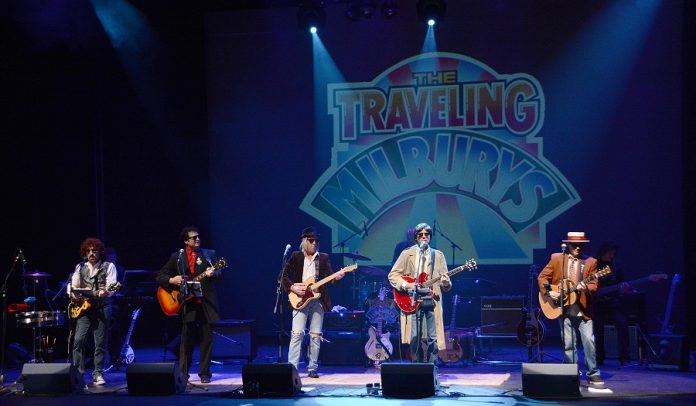 The Traveling Milburys is John Cassano as Jeff Lynne, Roy Leblanc as Roy Orbison,  Gerry Parsons as Tom Petty, Jerry Boyer as George Harrison, and Matt Greenberg as Bob Dylan. Each member of The Traveling Milburys comes from tribute bands dedicated to the individual artists. (Photo: The Traveling Milburys)