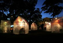 """""""Trophy"""" is a free outdoor art installation where audience members visit illuminated tents to listen as storytellers share their true stories of life-changing moments of change and transformation. Presented by Public Energy Performing Arts, """"Trophy"""" takes place on October 4 and 5, 2019, at Fleming Park in downtown Peterborough. (Photo: Allison O'Connor)"""