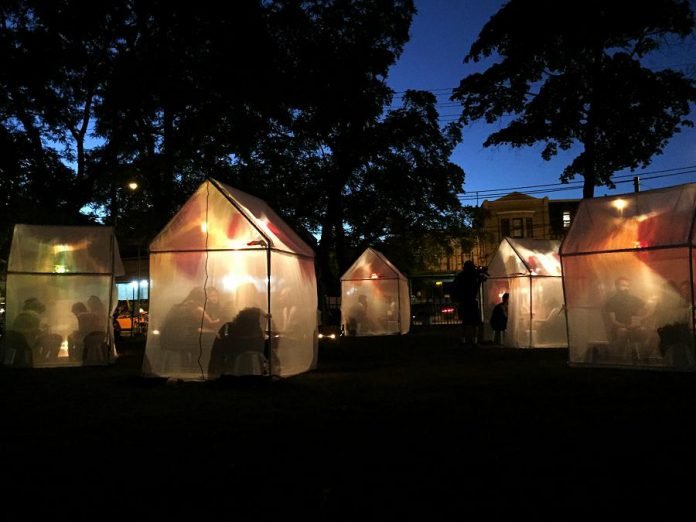 """Trophy"" is a free outdoor art installation where audience members visit illuminated tents to listen as storytellers share their true stories of life-changing moments of change and transformation. Presented by Public Energy Performing Arts, ""Trophy"" takes place on October 4 and 5, 2019, at Fleming Park in downtown Peterborough. (Photo: Allison O'Connor)"
