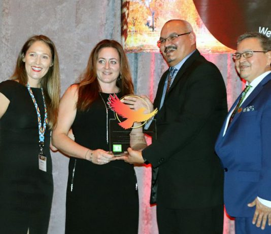 Curve Lake First Nation economic development officer Katie Young-Haddlesey (second from left) is presented with the Economic Development Officer of the Year Award at the Cando Conference in Gatineau, Quebec on October 30, 2019. Cando is an organization that promotes economic development in Indigenous communities across Canada. (Photo: Cando)