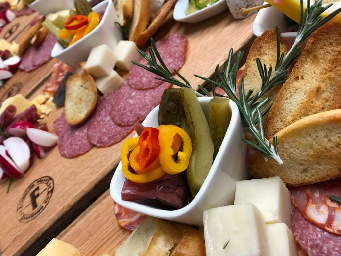 The taproom showcases Fenelon Falls Brewing Co.'s craft beers paired with an all-day menu, created using local and seasonal ingredients, including shared bites and charcuterie platters. (Photo: Fenelon Falls Brewing Co.)