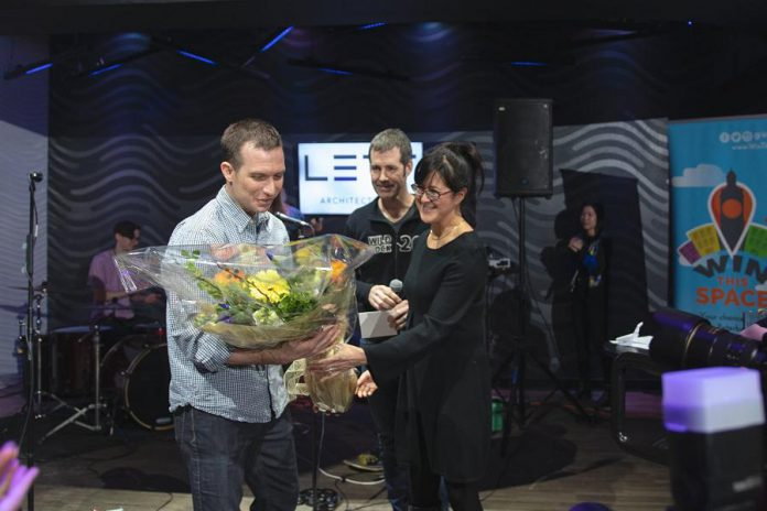 Jonathan MacKay of Sustain Eco Store accepting the grand prize for the 2019 Win This Space contest. Jonathan and his wife and co-owner Celine are hosting an official grand opening celebration of their new downtown Peterborough location on November 7, 2019. (Photo courtesy of Peterborough DBIA)
