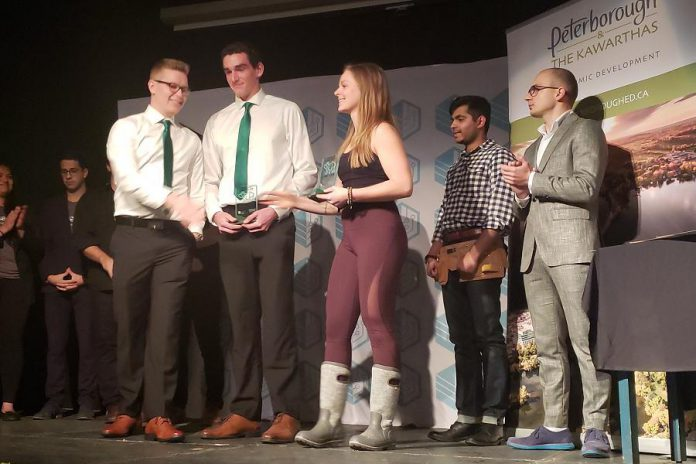 Runners up Shane Willis and Tanner Morrow of Eco-Care (left, in green ties) and Telsi Szanyi of Flow Codes. (Photo courtesy of Innovation Cluster)