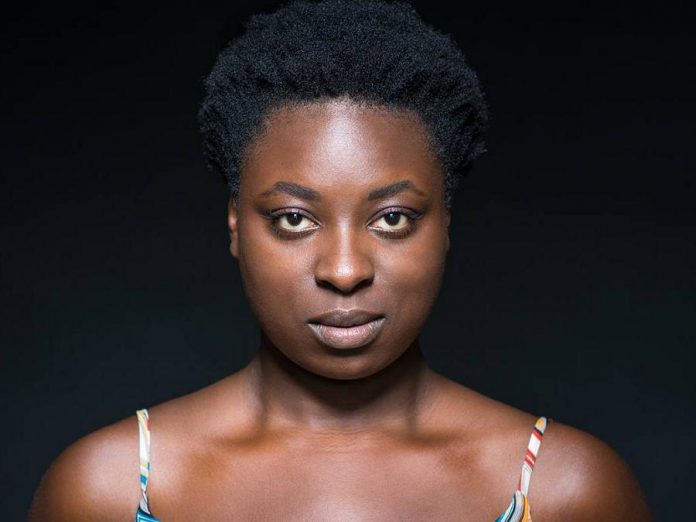 "Toronto-based Afro-Caribbean actor Khadijah Roberts-Abdulla reprises her lead role in the original 2018 Factory Theatre production of Kat Sandler's critically acclaimed play ""Bang Bang"" during a staged reading presented by New Stages Theatre Company at Market Hall Performing Arts in downtown Peterborough on November 10, 2019. She performs as Lila Hines, a former police officer who shot an unarmed black man and becomes the unwilling subject of a hit play that plays fast and loose with the actual facts. (Publicity photo)"