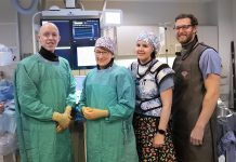 """Interventional Cardiologist Dr. Warren Ball (left) and members of the Cardiac Catheterization Lab team (Terri Matzke, Kate Graham, and Jeff Dunlop) at Peterborough Regional Health Centre (PRHC) thank donors for their continued generous support of the Cath Lab. This holiday season, the PRHC Foundation is asking people to help """"keep your heart here"""" by making a donation in support of the Cath Lab to replace and upgrade life-saving equipment. (Photo courtesy of PRHC Foundation)"""