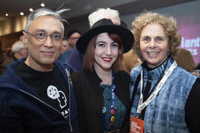 """ReFrame programmer Lester Alfonso (left) and board member Deborah Berrill (right) unwind with local filmmaker Slater Jewell-Kemker following the 2019 opening night screening of """"Youth Unstoppable"""". The opening night screening for the 2020 ReFrame Film Festival takes place at Showplace Performance Centre on Thursday, January 23rd, with the film to be announced soon. (Photo: Natelie Herault)"""