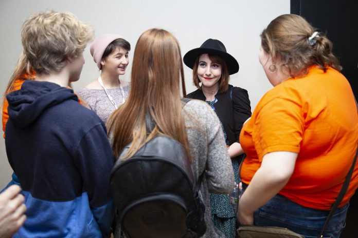 """Filmmaker Slater Jewell-Kemker chats with high school students from the Youth Leadership in Sustainability program following the opening night screening of """"Youth Unstoppable"""" at the 2019 ReFrame Film Festival. (Photo: Natelie Herault)"""