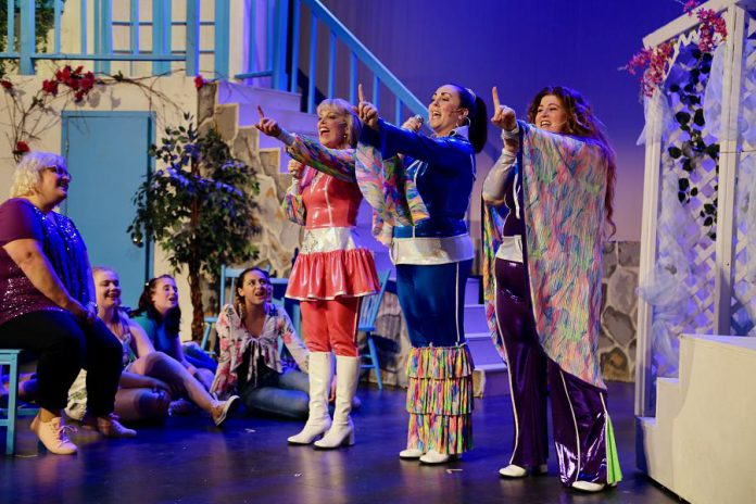 """Donna and the Dynamos (Christie Freeman as Tanya, Natalie Dorsett as Donna, and Lyndele Gauci as Rosie) in their '70s disco garb while singing """"Super Trouper""""  in the St. James Players production of the hit musical """"Mamma Mia!"""". (Photo: Wendy Morgan)"""