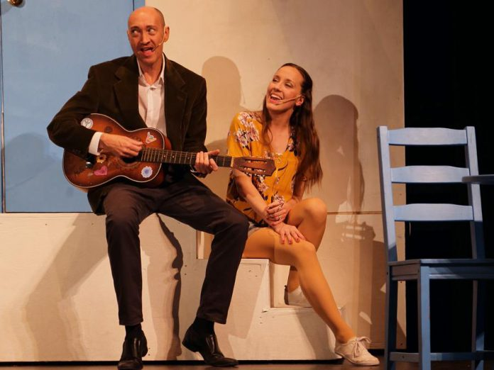 """Keevin Carter as Harry and Gillian Doiron as Sophie performing 'Thank You For the Music' in the St. James Players production of the hit musical """"Mamma Mia!"""". (Photo: Wendy Morgan)"""