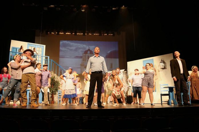 """Natalie Dorsett as Donna (front, far left) with Mark Gray as Bill, Warren Sweeting as Sam, and Keevin Carter as Harry in the St. James Players production of the hit musical """"Mamma Mia!"""". (Photo: Wendy Morgan)"""
