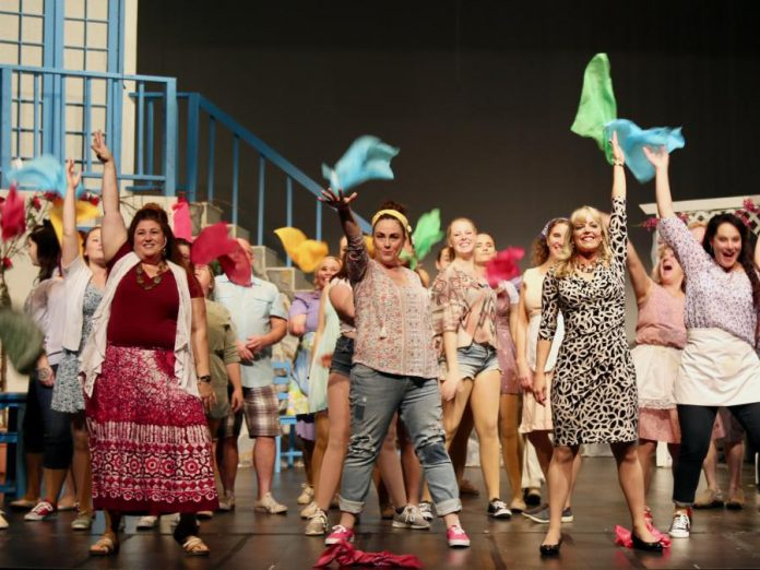 """Lyndele Gauci as Rosie, Natalie Dorsett as Donna, and Christie Freeman as Tanya with the cast of """"Mamma Mia!"""" as they perform ABBA's 'Dancing Queen' in the St. James Players production of the hit musical, which runs from November 8 to 16, 2019 at Showplace Performance Centre in downtown Peterborough. (Photo: Wendy Morgan)"""