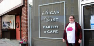 Rose Wilton, founder of The Rose Project, in front of Sugar Dust Bakery on Walton Street in Port Hope where you can donate toiletries or warm gloves, mittens, and hats for people in need. You can also bring donations to The Rose Project's inaugural Holiday Craft Show at the Town Park Recreation Centre on November 23, 2019, which features vendors offering a selection of hand-crafted items for your holiday shopping. (Photo: April Potter / kawarthaNOW.com)