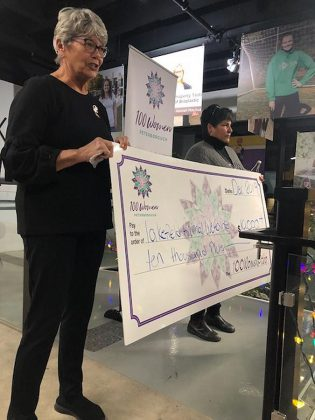 Lakefield Animal Welfare Society manager Janet Evans and past chair Mary Power accept the donation of more than $10,000 from collective philanthropy group 100 Women Peterborough in the lobby of the VentureNorth building in downtown Peterborough on December 17, 2019.  (Photo courtesy of 100 Women Peterborough)