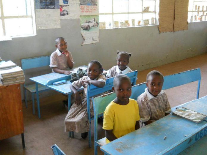 Students at Hungerpillar School in Liberia, West Africa, where families must pay for their children's education. As well as sponsoring students who otherwise wouldn't be able to attend school, Humanwave raises funds to pay the wages of teachers, who often choose to work for free when schools are unable to pay them. (Supplied photo)