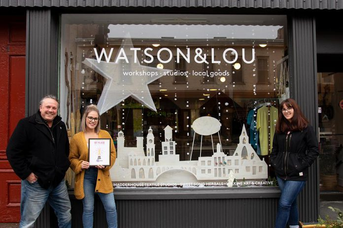 Watson & Lou co-owner Erin Watson (second from left) with the first place award for the annual Peterborough DBIA Holiday Decorated Window Contest. Also pictured is DBIA executive director Terry Guiel and DBIA intern and contest coordinator Olivia Boughen. (Photo courtesy of Peterborough DBIA)