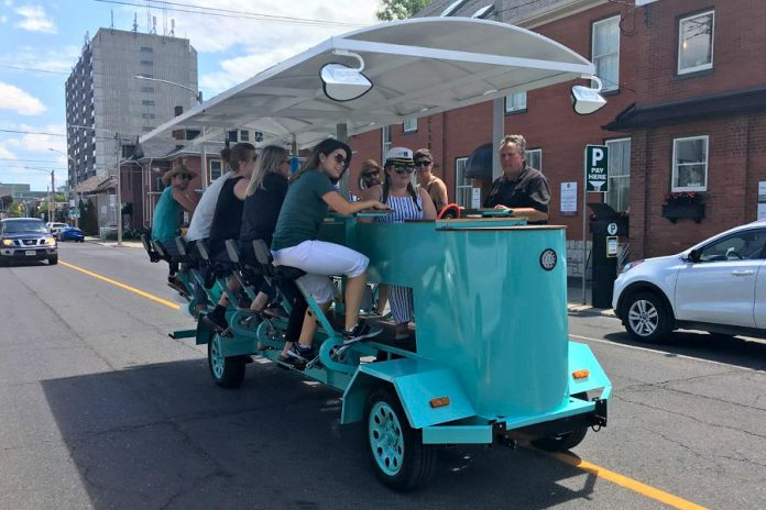 PedalBoro's 15-passenger party bike received a fair share of attention in July during the bike tour company's inaugural downtown tour from The Olde Stone Brewing Company to the Publican House Brewery before heading to Millennium Park. (Photo: Paul Rellinger / kawarthaNOW.com)