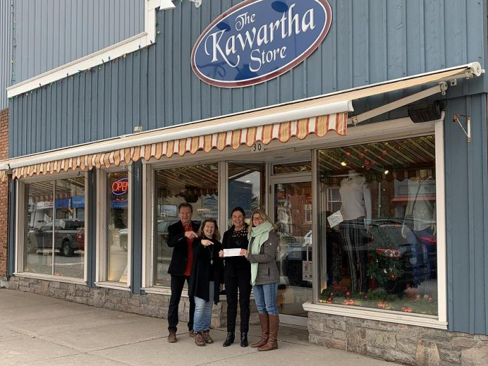 The Kawartha Store owners Al McIntosh (left) and  Trish Dougherty (second from right) with manager Trina Hubner (second from left) and Fenelon Falls and District Chamber of Commerce general manager Marylee Boston (right) with a cheque for $1,000 after The Kawartha Store won the Fenelon Falls Downtown Revitalization Award. (Supplied photo)
