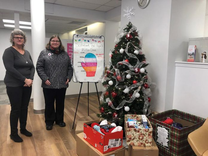 Scotiabank Port Hope manager Heather Hennings with The Rose Project founder Rose Wilson, who visited the branch on December 27, 2019 to pick up five boxes filled with 59 pairs of mittens, hats, scarves, toiletries, small gift cards, and granola bars. Branch employees, clients, and customers donated the items to support The Rose Project, which collects donations for the less fortunate in Northumberland County. (Photo: Cassidy Dawson)
