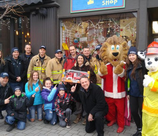 The Peterborough Professional Firefighters are donating $2,000 to The Toy Shop in downtown Peterborough so owner Jean Grant can use the funds to n to leverage deals for more than $6,000 worth of toys from her suppliers, who help with the initiative. The toys will be donated to the annual Salvation Army Toy Drive. (Photo courtesy of Peterborough DBIA)