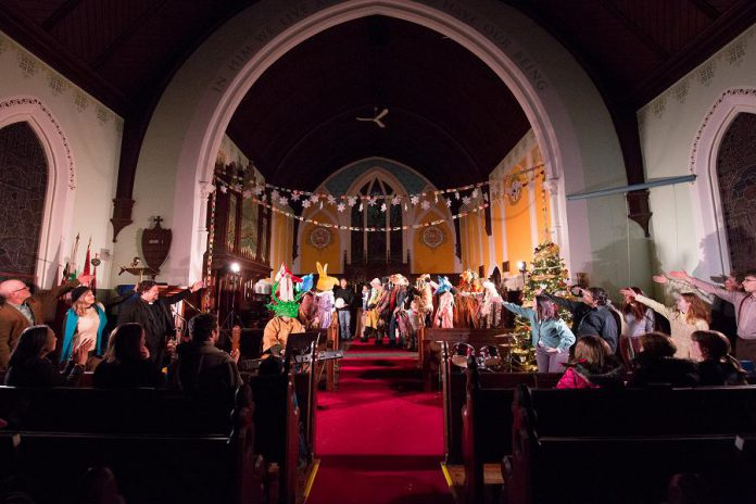 """The Fool of Cavan:  A Christmas Caper"" begins at St. Thomas' Anglican Church, proceeds through the streets of Millbrook, and then ends at the church for an old-fashioned Christmas concert. (Photo: Wayne Eardley / Brookside Studio)"