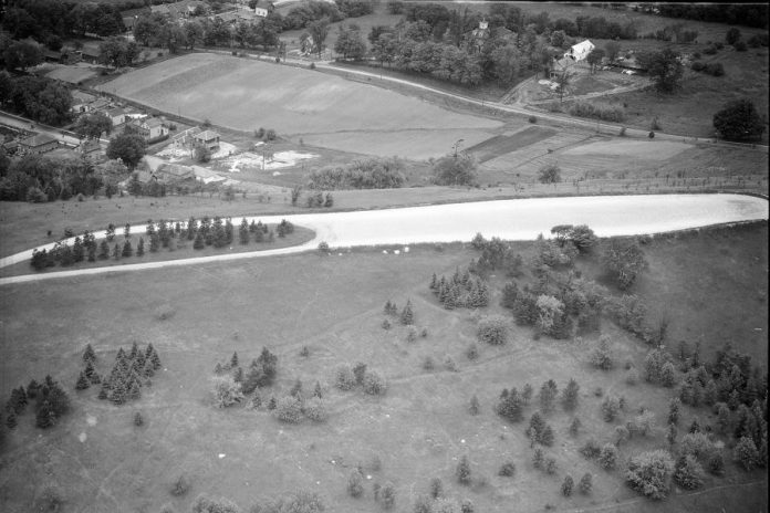 Armour Hill in Peterborough with the developing East City-Curtis Creek neighbourhood in the background, circa 1950. (Photo courtesy of Peterborough Museum and Archives, Parks Studio fonds, P-12-665-1)