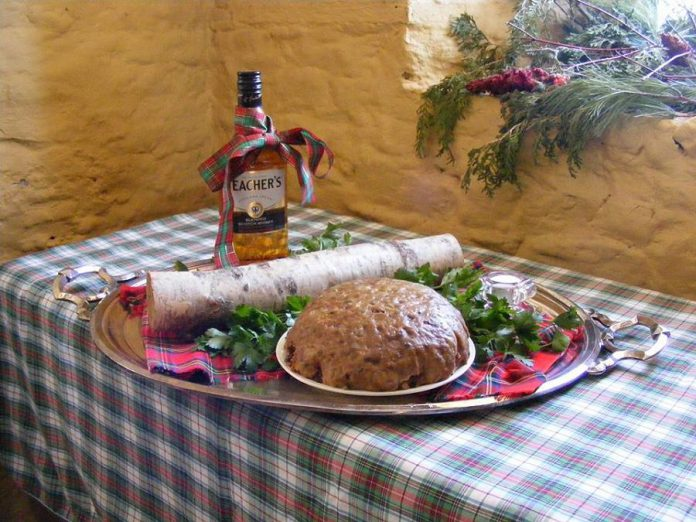 Hutchison House's Hogmanay celebration ushers in the New Year with gifts chosen to usher in good fortune: a log to start the fire, scotch to keep the spirits up, salt, and bread. (Photo: Hutchison House Museum)
