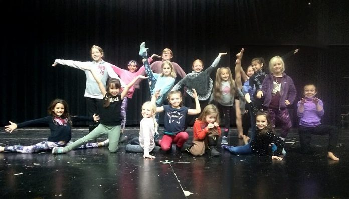 "Young members of the cast who portray flowers and dancers  in Arbor Theatre's original production ""Real Rad Red Riding Hood"", during a rehearsal in early December at Adam Scott Collegiate Vocational Institute. There will be a public performance of the play on December 12, 2019 at Showplace Performance Centre in downtown Peterborough. (Photo: Sam Tweedle / kawarthaNOW.com)"