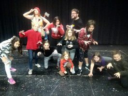 """A few of the nearly 50 cast members of Arbor Theatre's original production """"Real Rad Red Riding Hood"""", with a public performance on December 12, 2019 at Showplace Performance Centre in downtown Peterborough. Pictured at a rehearsal in early December are Naomi DuVall as The Forester, Nathan Bertucci as Basher, Aidan Shaughnessy as the Big Bad Wolf, with Ella Smit, Izzy Desjardins, Saffron O'Neil, Logan Michaelis, Saorse MacQuarrie, Molly Beaston, and Zoe Dunaway as the wolf cubs and Riordan MacQuarrie as Mouse. (Photo: Sam Tweedle / kawarthaNOW.com)"""