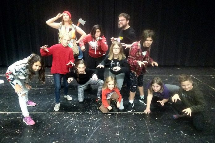 "A few of the nearly 50 cast members of Arbor Theatre's original production ""Real Rad Red Riding Hood"", with a public performance on December 12, 2019 at Showplace Performance Centre in downtown Peterborough. Pictured at a rehearsal in early December are Naomi DuVall as The Forester, Nathan Bertucci as Basher, Aidan Shaughnessy as the Big Bad Wolf, with Ella Smit, Izzy Desjardins, Saffron O'Neil, Logan Michaelis, Saorse MacQuarrie, Molly Beaston, and Zoe Dunaway as the wolf cubs and Riordan MacQuarrie as Mouse. (Photo: Sam Tweedle / kawarthaNOW.com)"