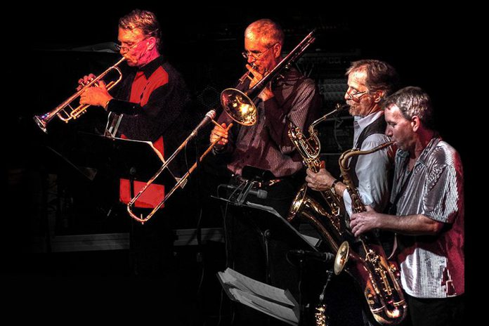 Rhythm and blues ensemble The Rocket Revue will perform at Market Hall Performing Arts Centre in downtown Peterborough on December 28, 2019. The 20th anniversary concert, dedicated to the late Buzz Thompson, will feature rhythm section Bobby Watson on gutiar, JP Hovercraft on bass, Rob Phillips on keyboards, and John Climenhage on drums, horn section Greg Weichel on trumpet, Jim Usher on tenor saxophone, Steve McCracken on tenor/baritone saxophone, and Rob Roy on trombone, and special guest performers Ryan Weber, Sam Weber, Marcus Browne, Jerome Godboo, Bridget Foley, and Jane Archer. (Photo: The Rocket Revue)