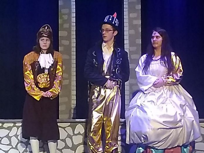 """Annika Goeckel as Cogsworth the Clock, Adam Airhart as Lumiere the Candelabra, and Lena Ross as  Mrs. Potts the Teapot in the Thomas A. Stewart Secondary School production of """"Beauty and The Beast - The Broadway Musical"""". (Photo: Sam Tweedle / kawarthaNOW.com)"""