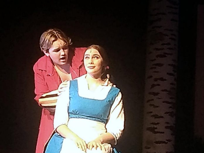"""Isaac Maker as  Gaston and Aimée Gordon as Belle  in Thomas A. Stewart Secondary School's production of """"Beauty and The Beast - The Broadway Musical"""". (Photo: Sam Tweedle / kawarthaNOW.com)"""