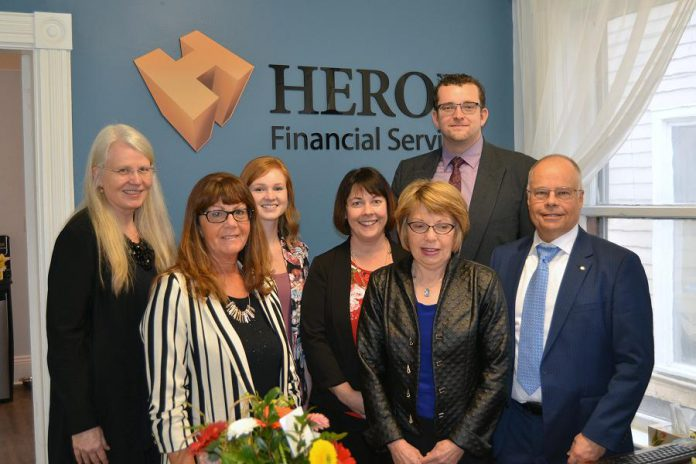 Roberta Herod (far left) started in the financial services business in the early 2000s, obtained her license to sell mutual funds, and threw herself behind the effort to grow Herod Financial Services, which was founded by her spouse Kevan Herod (far right). The company now has locations in Peterborough and Lakefield and seven team members.  (Supplied photo)