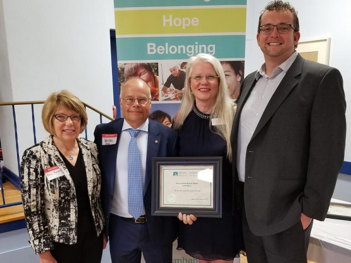 Kevan and Roberta Herod (centre) and members of the Herod Financial Services team with a distinguished service award from the Canadian Mental Health Association, Haliburton, Kawartha, Pine Ridge.  (Supplied photo)